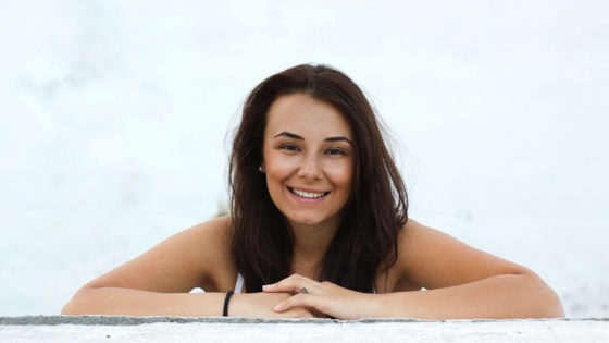 Woman with brown black hair smiling